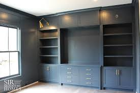 office built in. gray home office with built ins and brass swing arm sconces in