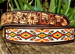 beaded belt with dogwood tooling hand dyed border and brand and dark brown filigree