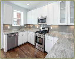 granite countertops with white cabinets kitchen