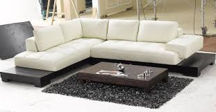 white leather low profile sectional chaise lounge sofa bed with black wooden base for modern living room oak coffe table and carpet tiles ideas low profile couch r32