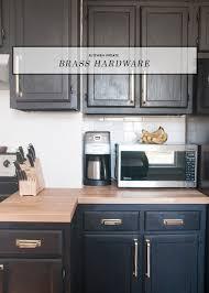 brass hardware black cabinets