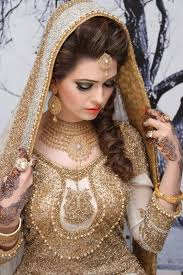 in the past more gaudy colors were seen in bridal makeup and dresses but the trends have changed in 2016 and 2017 now the off white and beige colors look