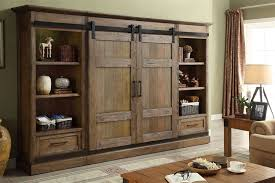 hunts point 4 piece sliding door entertainment wall in weathered pine finish by parker house