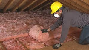 Continuing To Install Second Layer Of Batt Insulation.