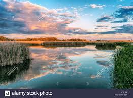 <b>Colorful lake</b> at <b>sunset</b> in Tablas de Daimiel National Park. Ciudad ...