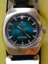 elgin gold plated case adult wristwatches vintage 1970 s elgin mens 17 jewels swiss automatic watch very good condition