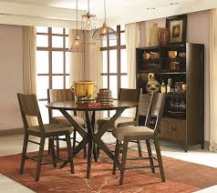5 pieces vintage pub style dining room sets design for small rustic dining room spaces with round dark wood dining table and chairs with light brown fabric