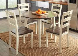 woodanville round dining room set with 4 chairs