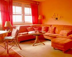 living room orange wall and decor