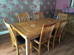 beautiful marks and spencer malabar range solid wood dining table and 8 leather seated chairs