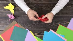 How To Make A Lotus Flower Out Of Paper Hands Of Man Folding Lotus Stock Footage Video 100 Royalty Free 1010409083 Shutterstock