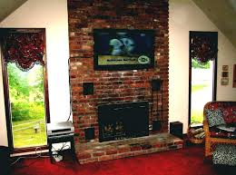 hanging tv over fireplace above too high where to put cable box wood burning hang hanging tv over fireplace