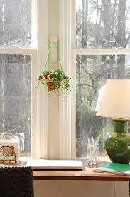 Image of DIY Wall Hanging Planter held on a hook by a window
