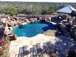 Pool with large water feature, outdoor living space and spa