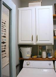 Laundry room makeovers charming small Pinterest Farmhouse Laundry Room With Antique Door Diy Beautify Farmhouse Modern Laundry Room Reveal Diy Beautify