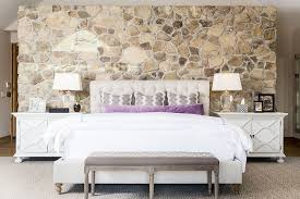view in gallery bedside tables bring symmetry to the contemporary bedroom with stone wall design cashmere interior