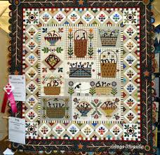 Loose Threads: Indiana Heritage Quilt Show 2012 & This quilt won ribbons for both Exemplary Hand Quilting and 2nd place in  the Applique' Bed Quilt category. The maker is Betty Ekern-Suiter, Racine,  AL. Adamdwight.com