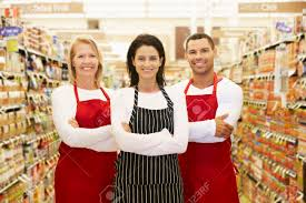 supermarket worker images stock pictures royalty supermarket worker supermarket workers standing in grocery aisle