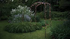 amazing garden lighting flower. String Lights On A Stately Arch Invite Visitors To The Evening Garden.  White And Pale Blue Flowers Add Allure. Amazing Garden Lighting Flower