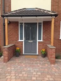 Richmond style front door. Painted in Gallant Grey by Dulux. Porch canopy  supported by