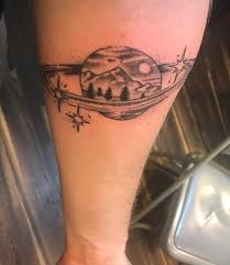 Saturn With A Mountainscape Inside My First Tattoo Done By John