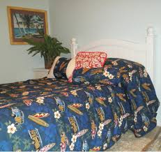 bedspread with woody cars surfboards and hibiscus flowers on a masculine navy blue duvet cover uk