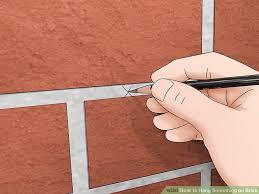 image titled hang something on brick step 4