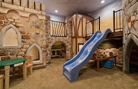 Basement ideas for kids area Kids Playroom View In Gallery Basement Playroom With Slide Entry Design Decoist Basement Kids Playroom Ideas And Design Tips