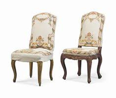 chair slipcovers each with an arched padded back and seat covered with sched white fabric one gilt the other one parcel gilt 43 ½ in 110 cm