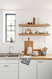 Wall mounted kitchen shelves Kitchen Storage Simple Unstained Oak Wood Floating Shelves On White Painted Wall With Metal Bracket And Flat Eased Edge Profile Captivating Wall Mounted Kitchen Shelves Pinterest Simple Unstained Oak Wood Floating Shelves On White Painted Wall