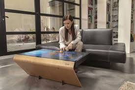 A shining, futuristic, and sleek table that serves as a sound system, refrigerator, party hub, storage space and coffee table next to your couch.built with r. A Guide To High Tech Coffee Tables Mansion Global