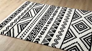 haku geometric moroccan tribal area rug in black and white