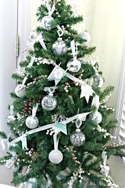 Christmas-Tree-with-Silver-Decorations-682x1024