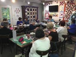 Sager Creek Quilts - Home | Facebook & Image may contain: one or more people, people sitting, table and indoor Adamdwight.com
