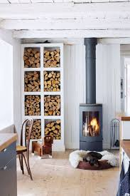 Iron fireplace like a stove in a house with fire, scandinavian interior modern design, white room. 25 Home Wood Burning Stove Ideas Digsdigs
