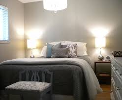 White Grey Patterned Comforter On King Size Beds Without Headboard Next To  White Drawer Cabinet And Stool On Laminate Floor