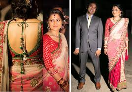 she plemented the sari with custom made kundan style for the bangalore wedding and reception makeup