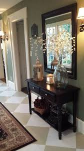 When she told us she spent just $5 on this entryway makeover we weren't  expecting the gorgeous result:   Foyer paint, Diamond pattern and Foyers