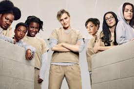 black family watching tv. binge: orange is the new black back with a brand season family watching tv