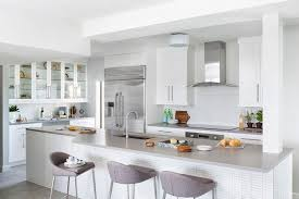 white grid tiled kitchen island with gray linen counter stools