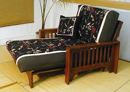 double black futon chair with black slipcover