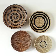 decorative baskets to hang on wall decorative basket wall art set of woven wicker wall baskets