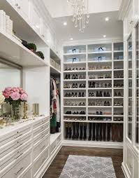 walk in closet women. Perfect Women This Elegant White Closet Has Customized Storage For Boots Flats And Heels  On One Long Wall A Dresser With A Large Gilded Mirror Sits The Far Wall  On Walk In Closet Women
