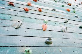 grunge surface of an artificial rock climbing wall with toe and hand hold studs stock photo on rock climbing artificial wall with grunge surface of an artificial rock climbing wall with toe and