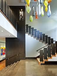Mid-sized contemporary wooden u-shaped staircase idea in Toronto