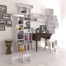 white cubit shelving surrounding desk interior design