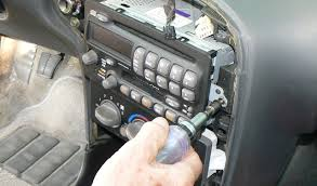 gm passlock security fix remove the bezel around your radio you can pry it loose a large screwdriver or a sturdy dinner knife once you get it loose disconnect the cables