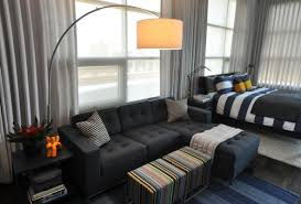 Studio Apartment Bachelor Pad Bedroom with Grey Curtains and Daybed Sofa  and Arc Lamp