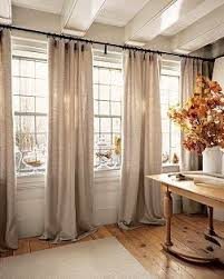 pictures of living room curtains. one long curtain rod above multiple windows. move divider behind curtains. pictures of living room curtains