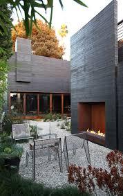 best 25 modern outdoor fireplace ideas on modern outdoor love seats chimnea outdoor and outdoor areas